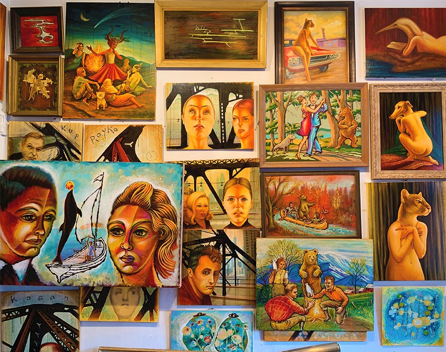 collage of paintings on wall