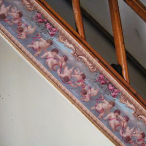 """cherub"" wallpaper lines a staircase"
