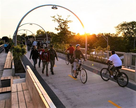 sunset on people using The 606 trail